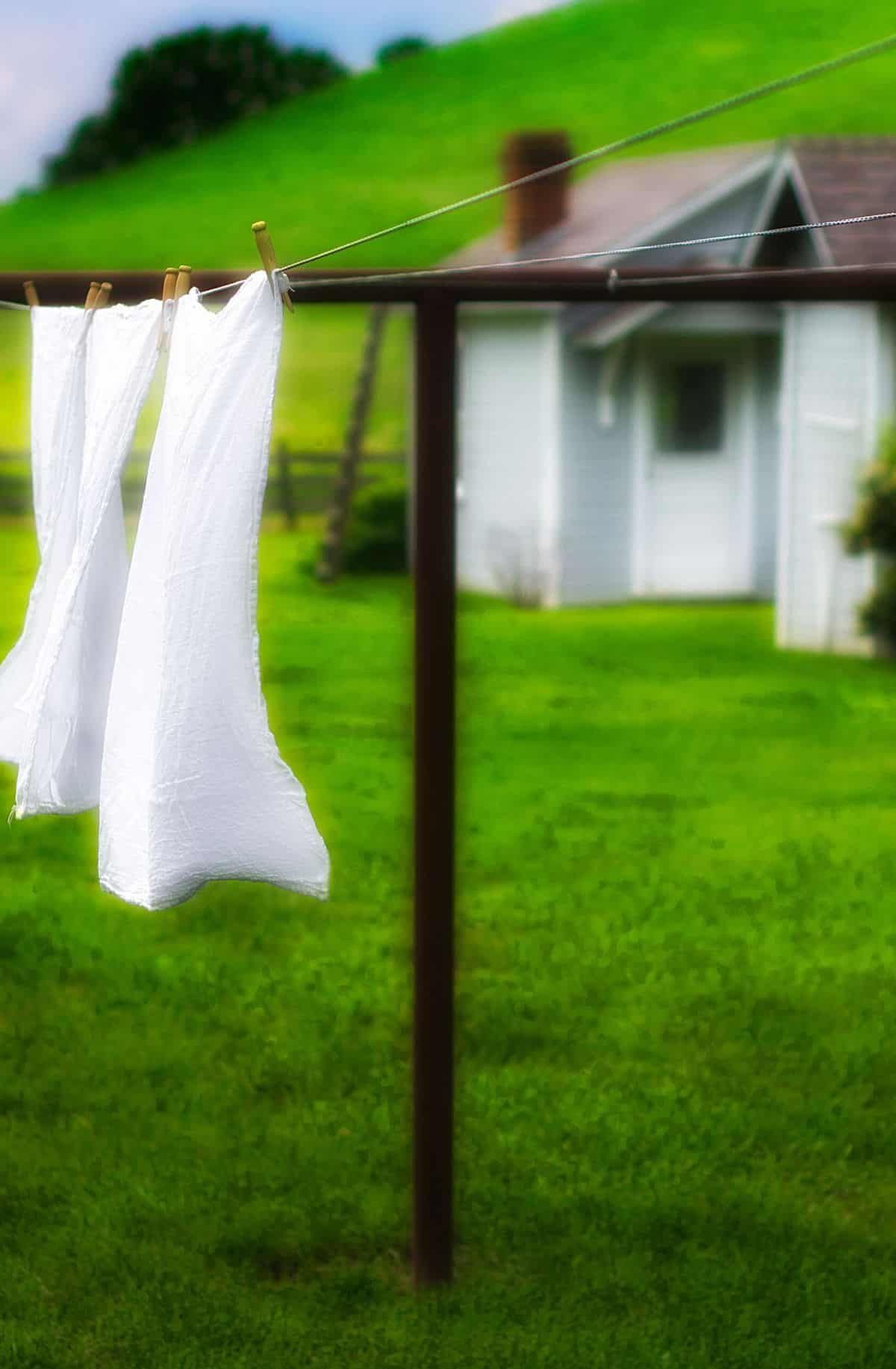 clothes line with white sheets