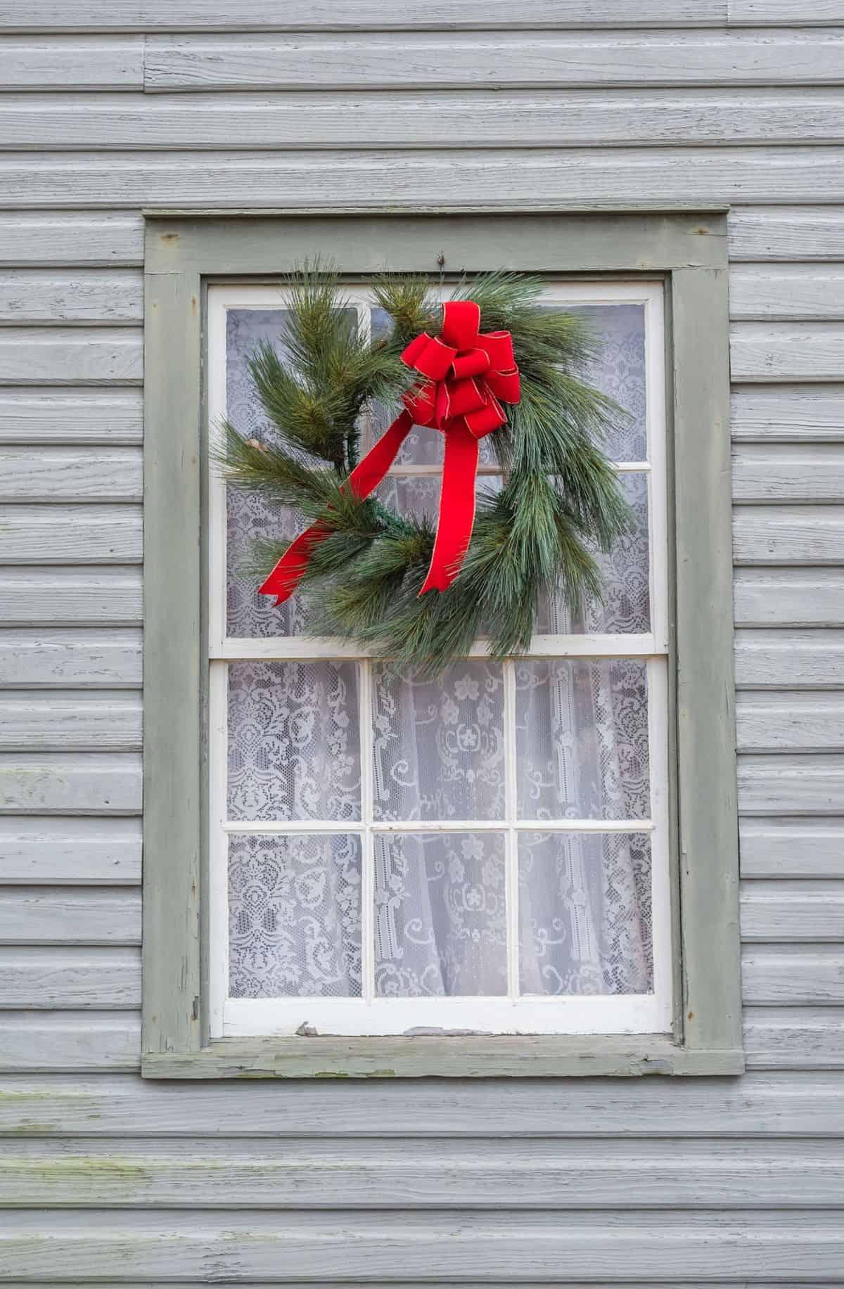 christmas wreath on outside window