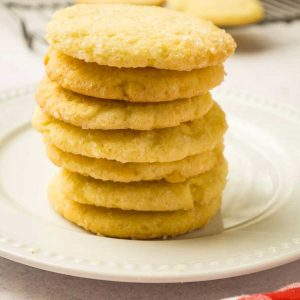 stack of round sugar cookies on plate