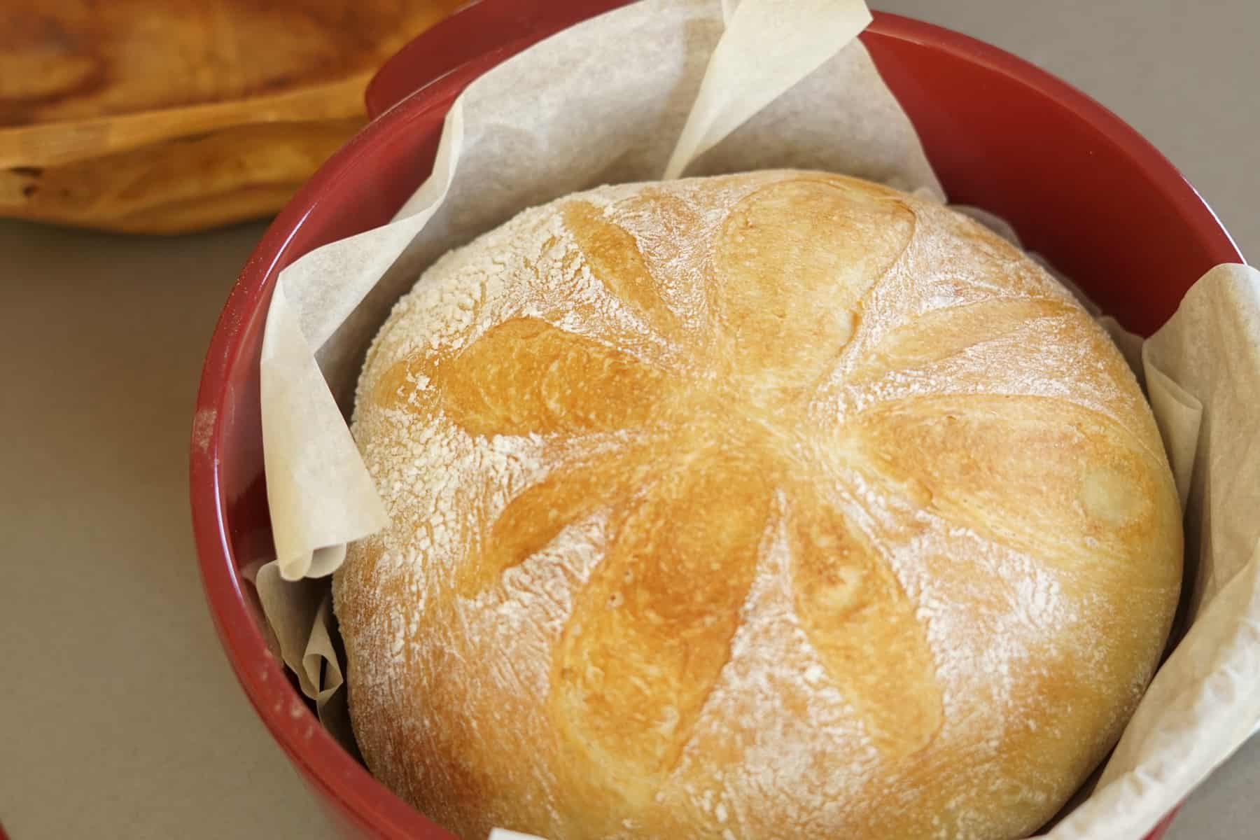 round French bread loaf in red dutch oven
