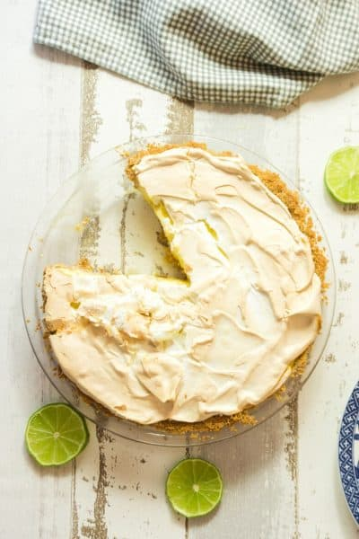 key lime pie with meringue on white wood