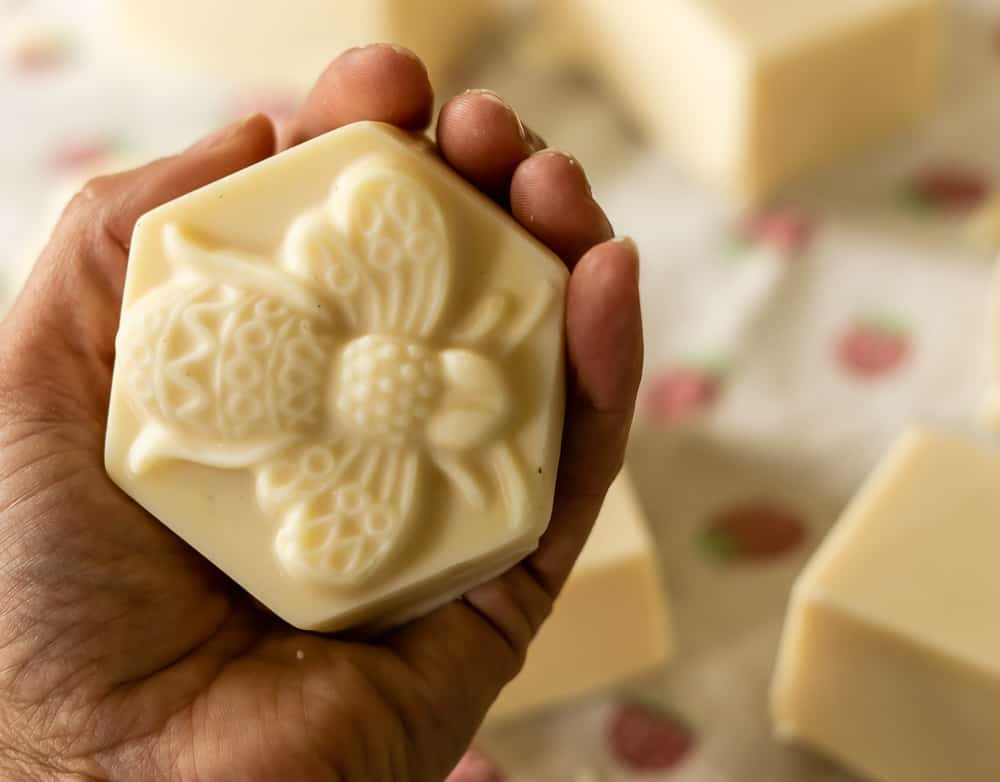 bar of beeswax and honey soap with bee design