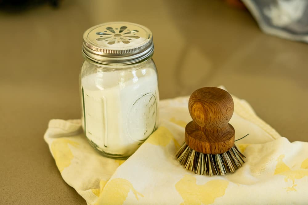 mason jar with baking soda for cleaning kitchen