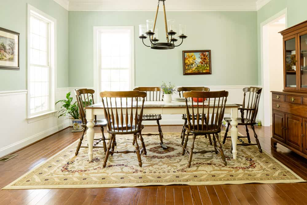 dining room decorated on a budget- blue walls and cherry furniture