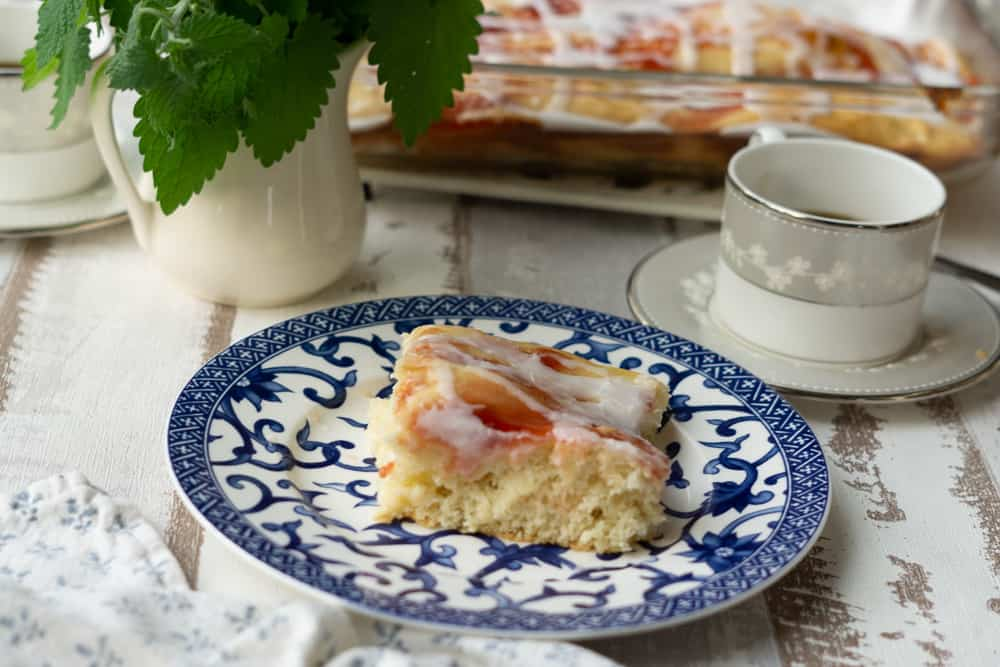 slice of strawberry bread at breakfast table with coffee
