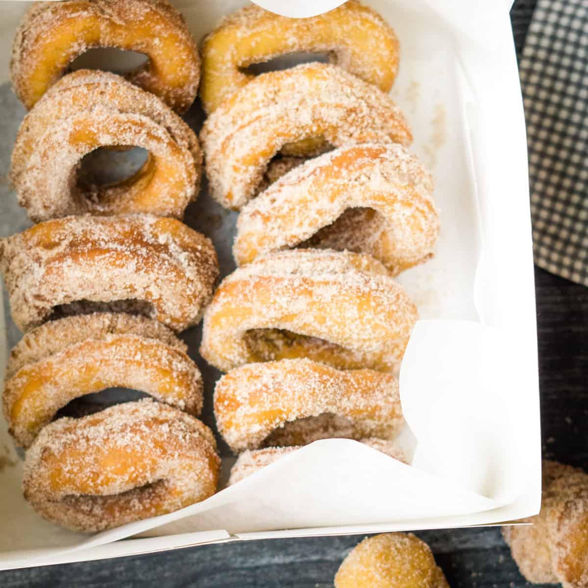 apple cider doughnuts in white cardboard box