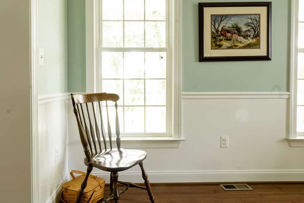 chair in front of window with Woodlawn Blue upper wall and Chantilly lace lower half