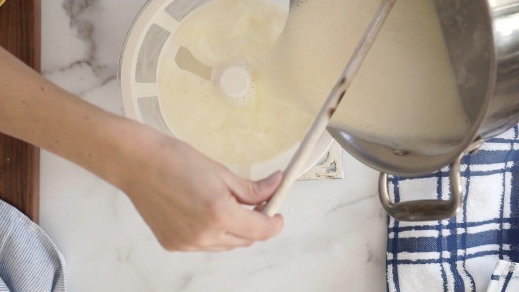 pouring vanilla  ice cream custard into strainer