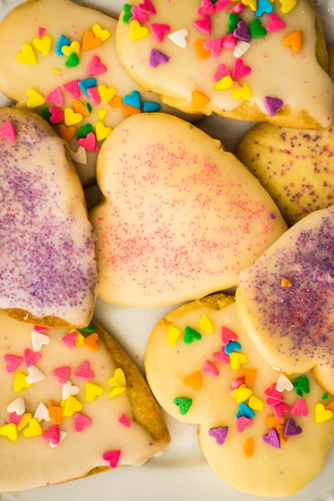 close up of glazed sugar cookies with sparkling sugar and sprinkles