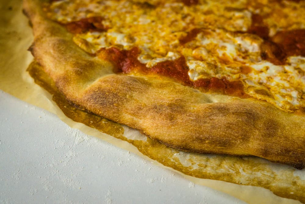 finished pizza on parchment paper