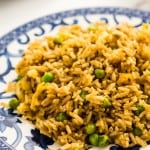 spicy fried rice on blue and white patterned plate