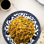 marble counter with spicy fried rice in blue and white bowl