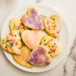 heart shaped rolled sugar cookies on white plate