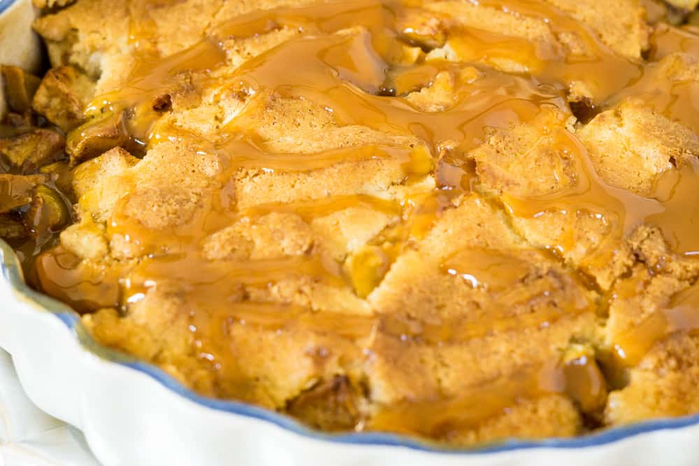 close up of topping of apple cobbler, freshly poured caramel