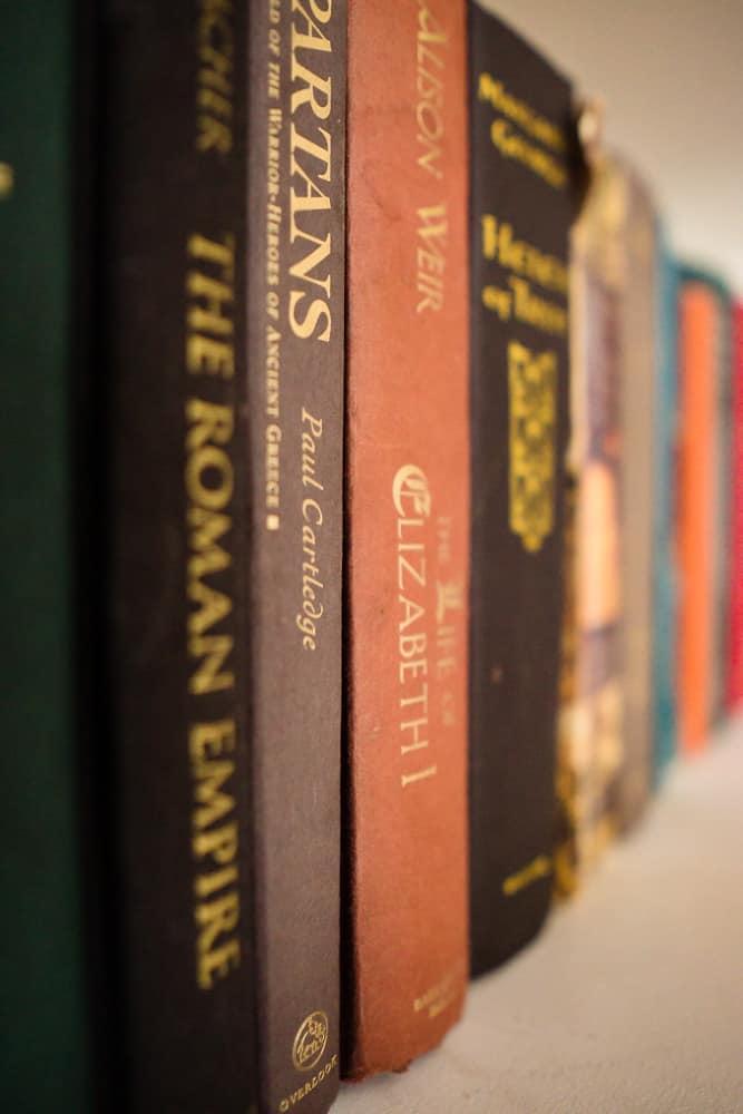 12 hardcover books on library shelf