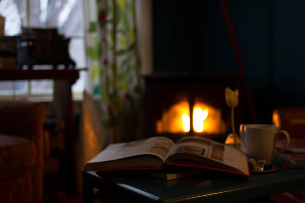 wood stove with open book in front