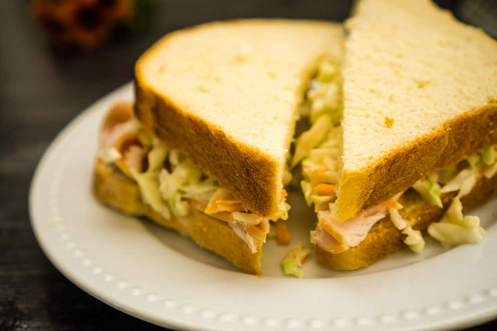 sandwich on white bread with coleslaw
