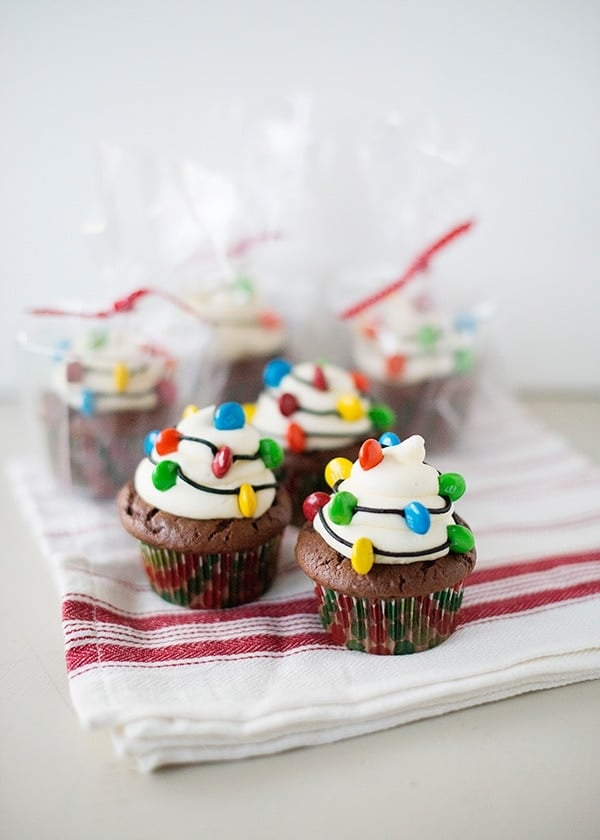 christmas light cupcakes on red and white towel