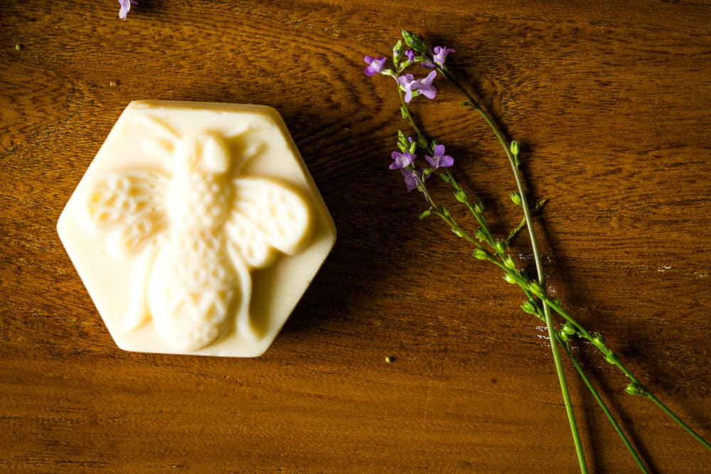homemade soap with bumblebee design and purple wildflower