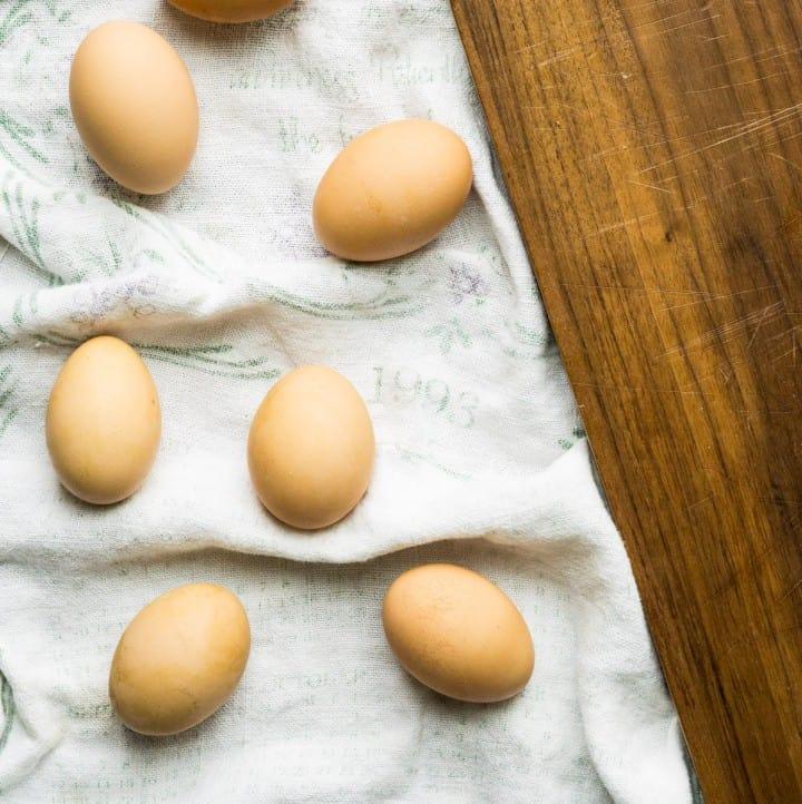brown eggs on tea towel