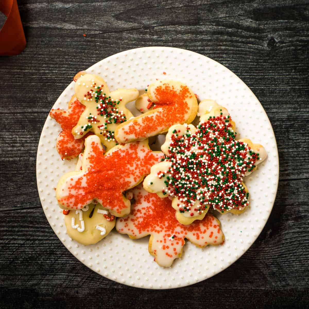 plate of sugar cookies with christmas sprinkles