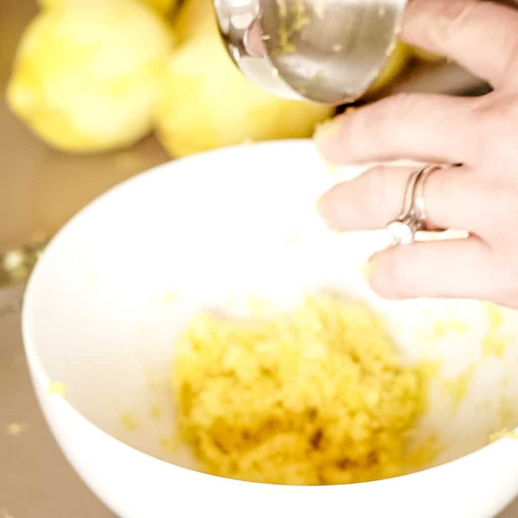 lemon zest and sugar in small white bowl