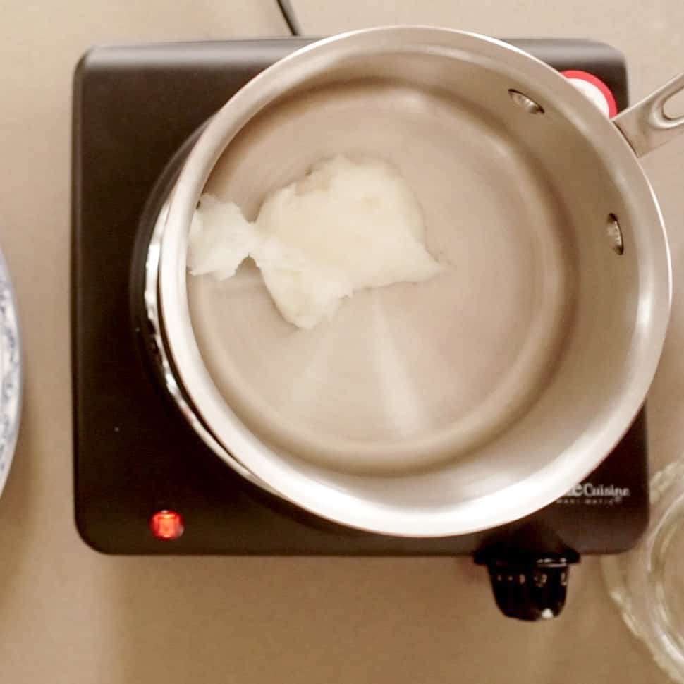 coconut oil melting in small pan