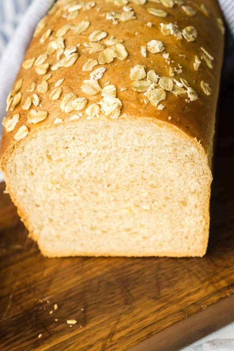 loaf of oatmeal sandwich bread with slice cut out