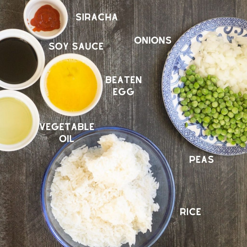 ingredients for easy fried rice in bowls on wooden surface