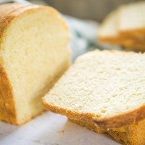 sliced sourdough egg bread on white background
