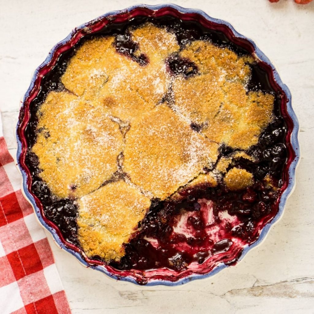 triple berry cobbler in round dish