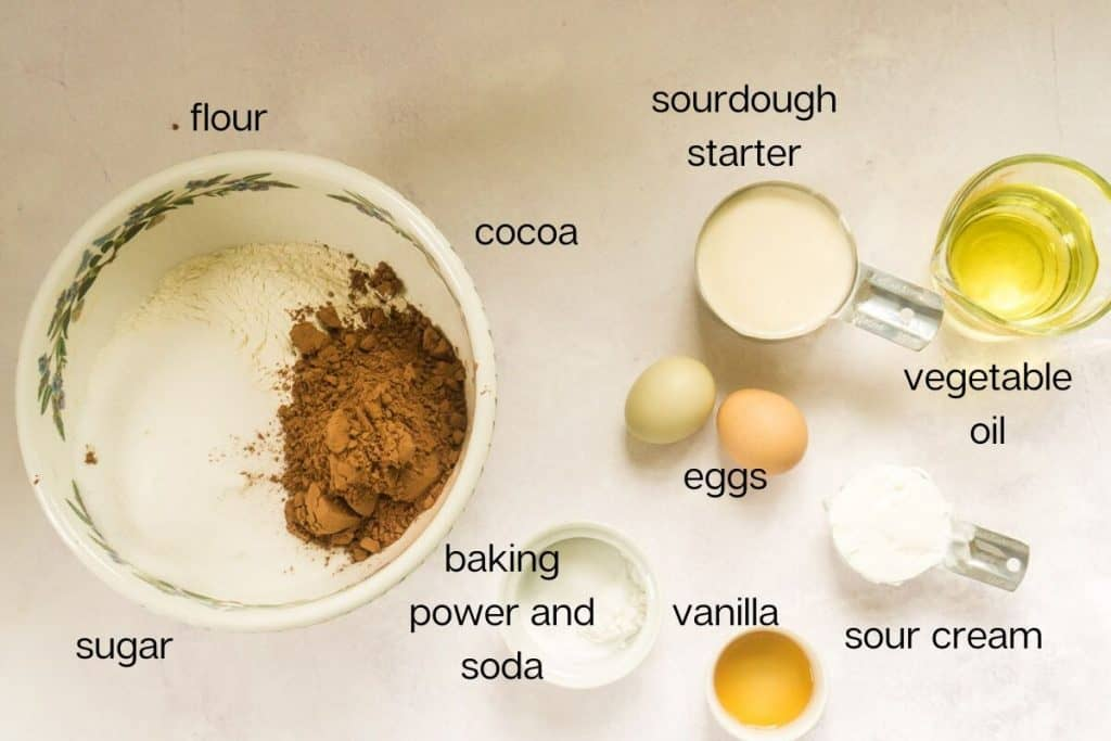 cake ingredients laid out on white surface