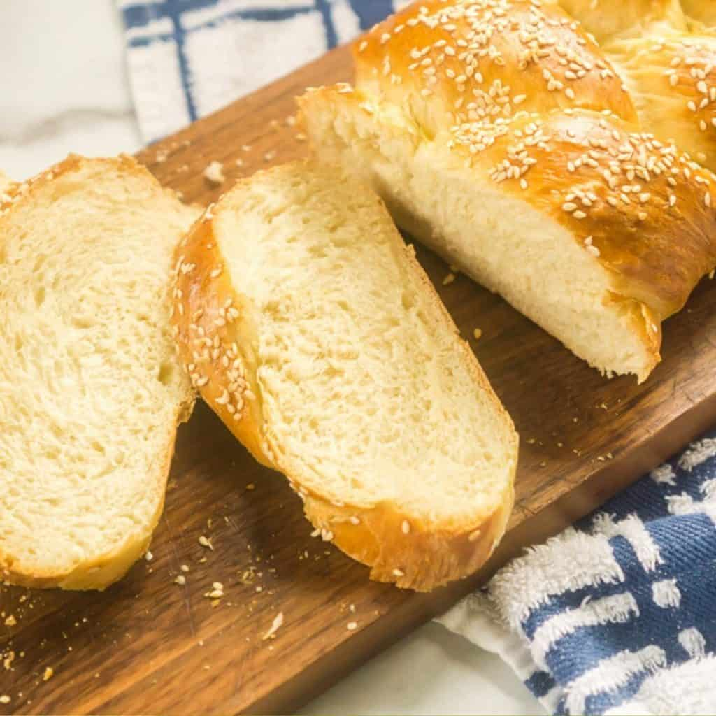 braided Italian bread topping with sesame seeds
