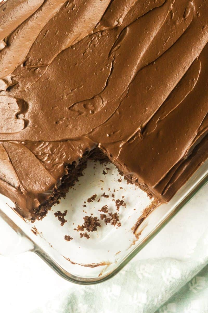 sourdough chocolate cake with icing with slice cut out