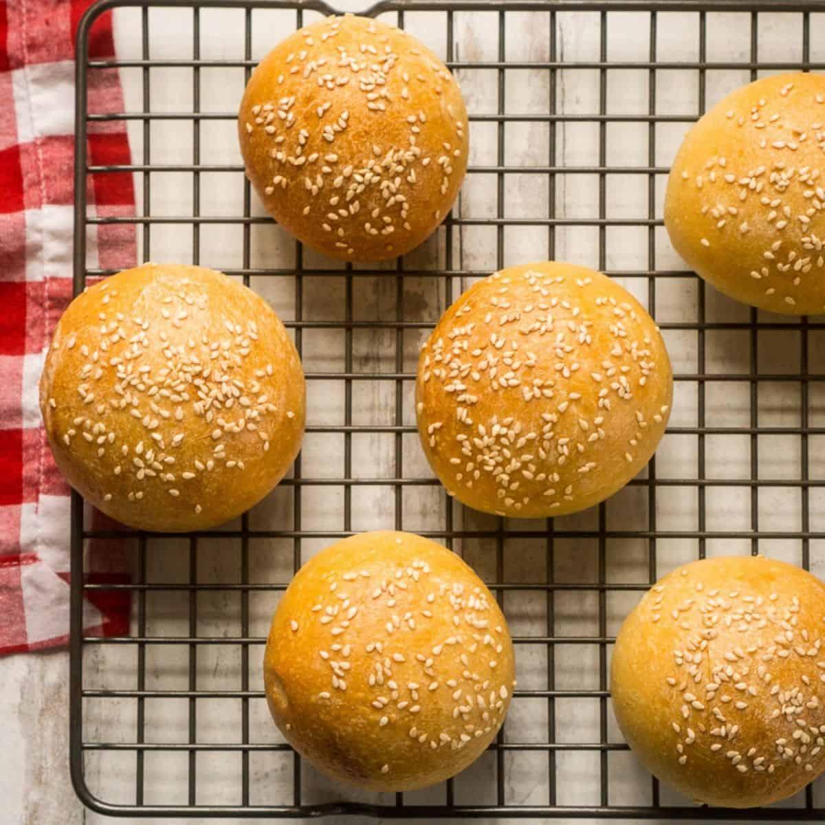 6 sourdough burger buns on cooling rack