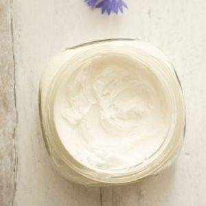 jar. showing white homemade body cream