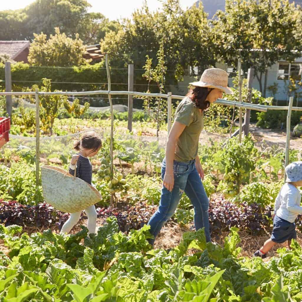 woman and children in vegetable garden