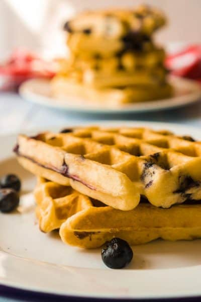 stack of blueberry waffles on plate