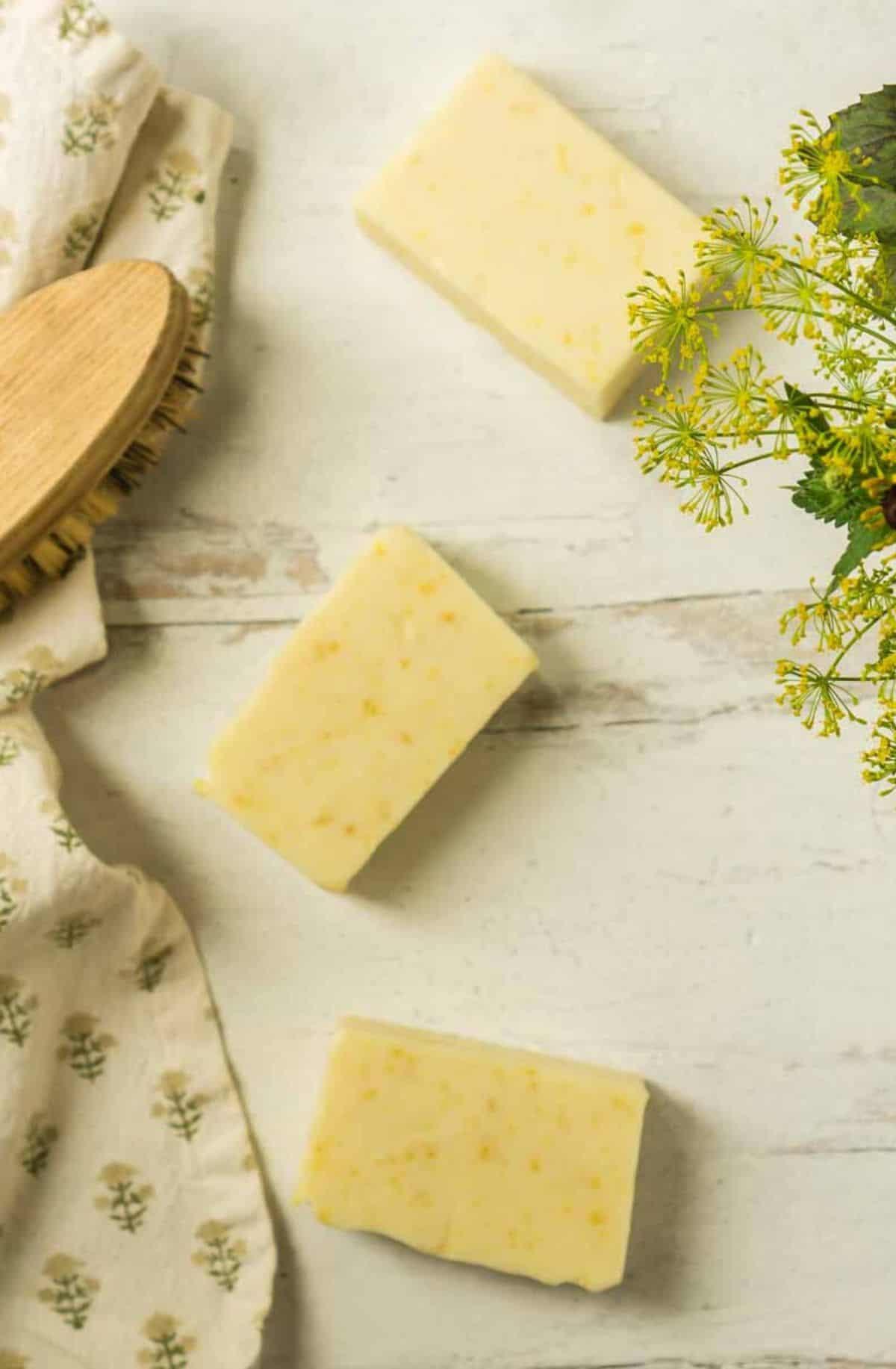 3 bars lemon zest soap on white background