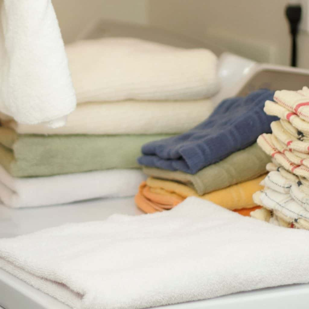 folding towels on top of washer and dryer