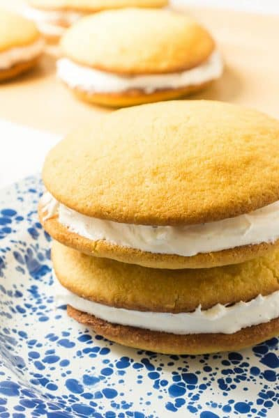 2 vanilla Whoopie Pies on blue and white plate