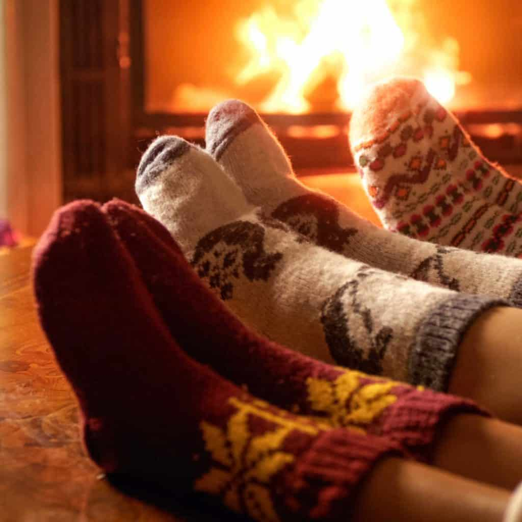 cozy evening in christmas socks by fire