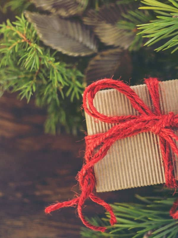 Kraft paper christmas gift with homemade greenery