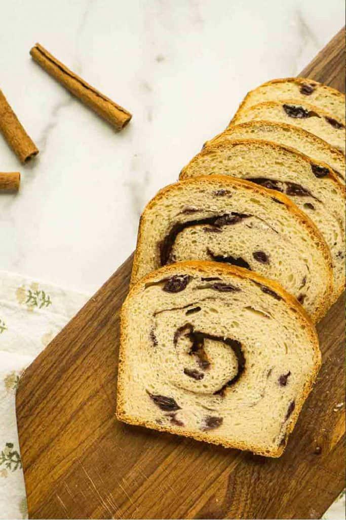 6 slices of sourdough raisin bread on wooden board