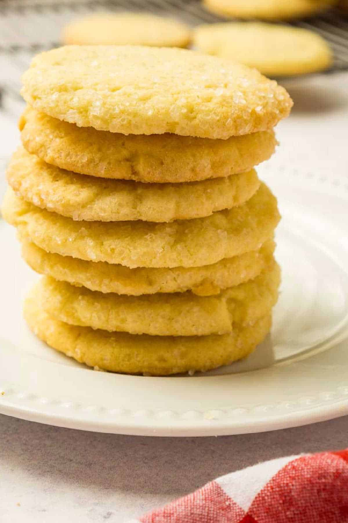 stack of sugar cookies on white plate