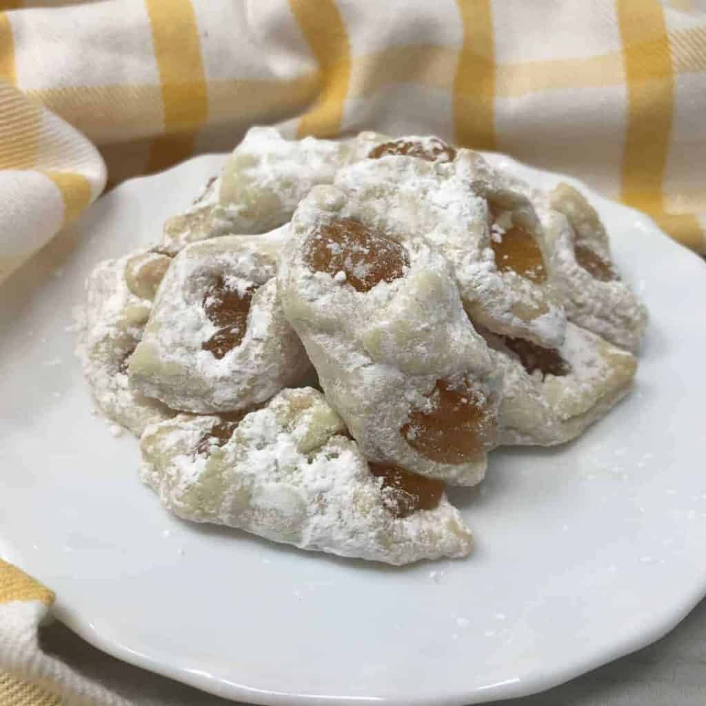 powdered sugar fruit filled cookies
