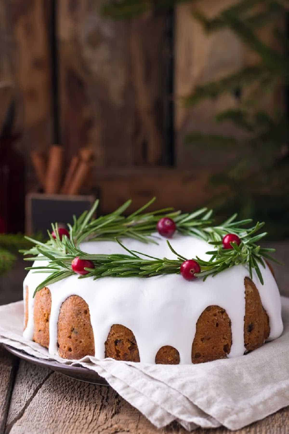 Bundt Cake with cranberries on wooden surface