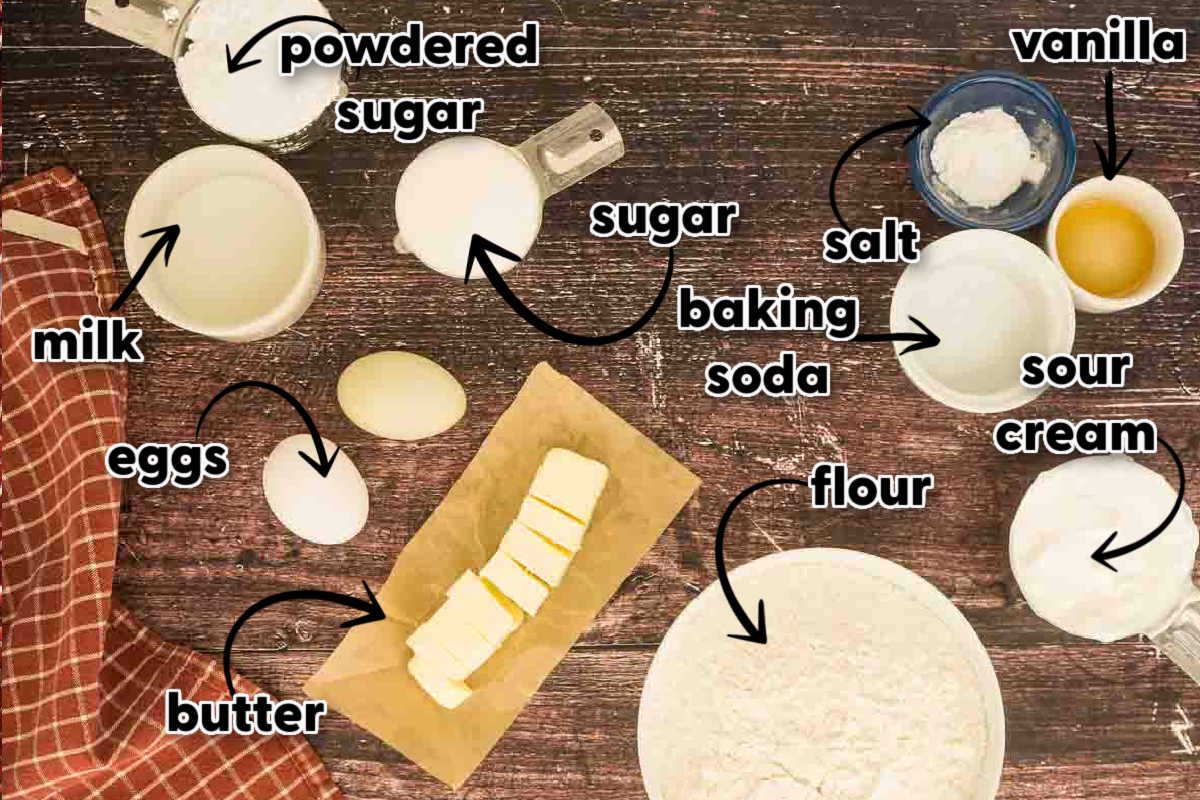 sour cream cookie ingredients laid out on wooden surface