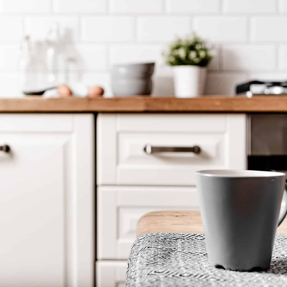 white kitchen and grey blue mug