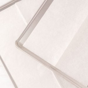2 rimmed cookie sheets pined with parchment